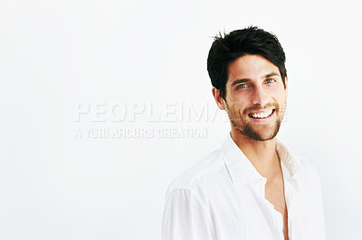 Buy stock photo Happy portrait of a young man smiling against a backgorund with copyspace