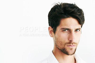 Buy stock photo Closeup portrait of a serious male staring at the camera against a white background