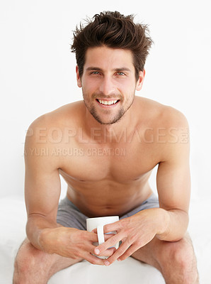 Buy stock photo Portrait of a handsome male sitting in his underwear drinking a cup of coffee/tea