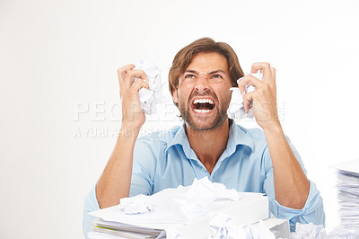 Buy stock photo Frustrated male scrunching up sheets of paper screaming and shouting in rage - Copyspace