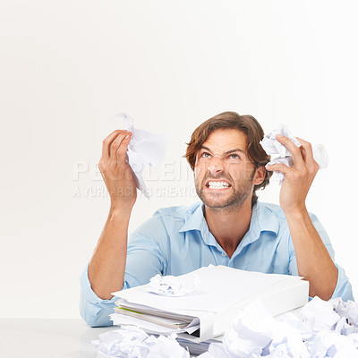 Buy stock photo Angry male scrunching up papers in frustration looking up - Copyspace