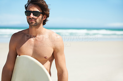 Buy stock photo An attractive young man about to go surfing