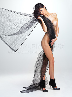 Buy stock photo Nude woman with a length of fine black netting draped over her shoulder, isolated on white