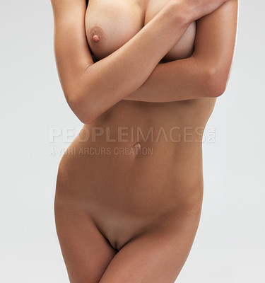 Buy stock photo Cropped view of a naked woman's mid-section