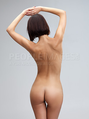 Buy stock photo Rear view of a naked woman's buttocks