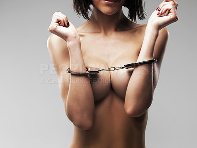 Buy stock photo Cropped view of a naked woman in handcuffs