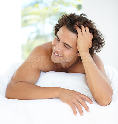 Buy stock photo A handsome young man enjoying a relaxing day at home