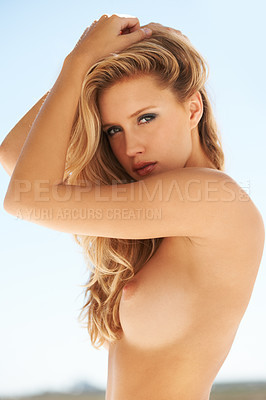 Buy stock photo Shot of a gorgeous young woman posing topless outside