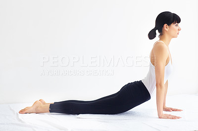 Buy stock photo Young healthy woman in a yoga position while isolated on white