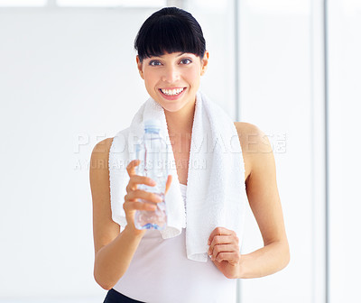 Buy stock photo Pretty young woman in fitness gear holding a water bottle