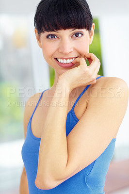 Buy stock photo Lovely young woman giving a big smile with her hand to her face while indoors