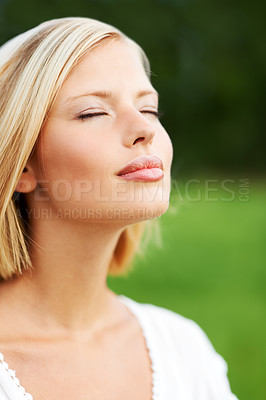 Buy stock photo Lovely young woman savoring the breeze outdoors