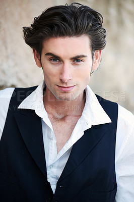 Buy stock photo Closeup of a handsome young male wearing a vest and smiling at the camera