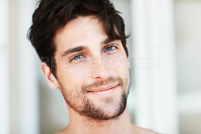 Buy stock photo Handsome young male smiling and looking at the camera