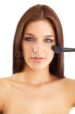 Buy stock photo Portrait of a beautiful young brunette applying makeup to her face