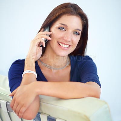 Buy stock photo Portrait of a beautiful young woman speaking on her mobile phone