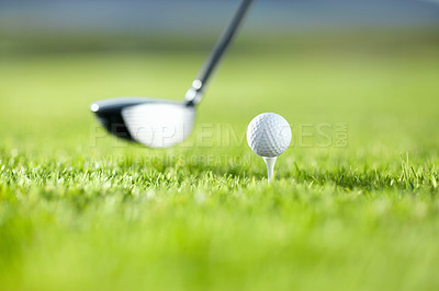 Buy stock photo A golf club about to tee-off with a white ball on a golf course