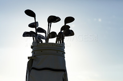 Buy stock photo Silhouette of a golf bag with the sky in the background