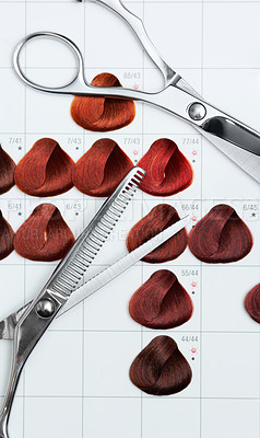 Buy stock photo A hair colour chart depicting various reds and two pairs of scissors
