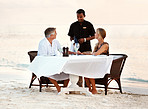 Middle aged couple having dinner at the sea shore