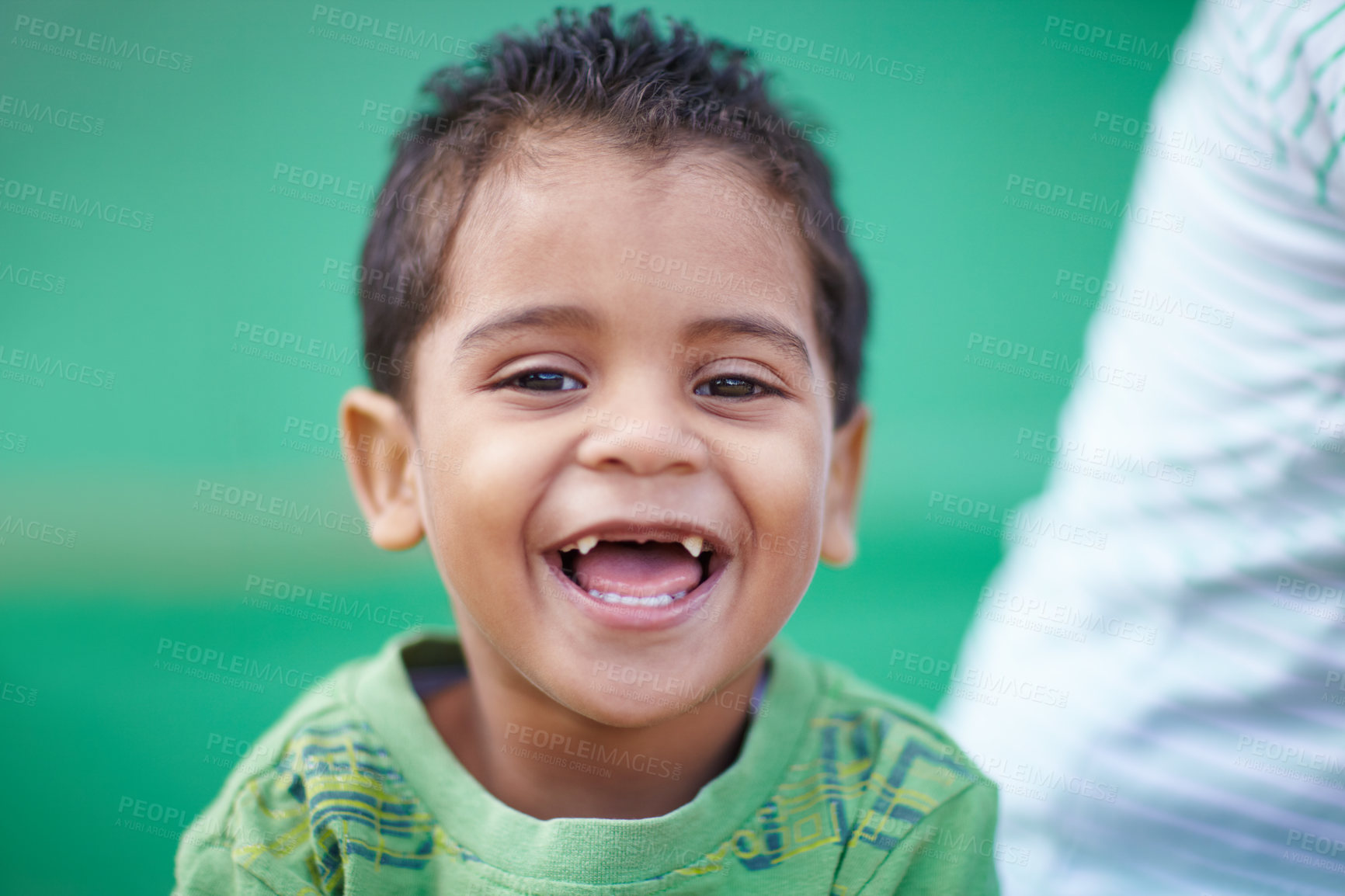 Buy stock photo Cute little preschooler laughing and smiling at the camera
