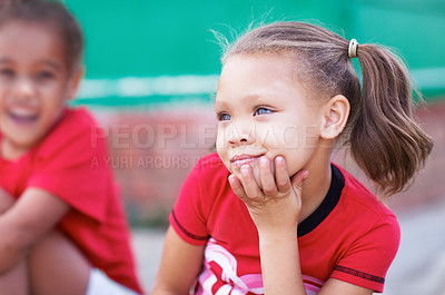 Buy stock photo Cute little preschoolers sitting together outdoors