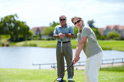 Buy stock photo Mature married couple teeing up to play a round of golf together