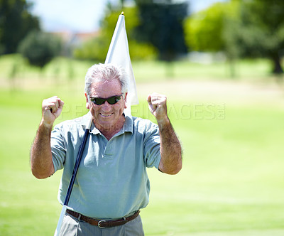 Buy stock photo Portrait of an excited and victorious senior golfer holding up his fists smiling with success