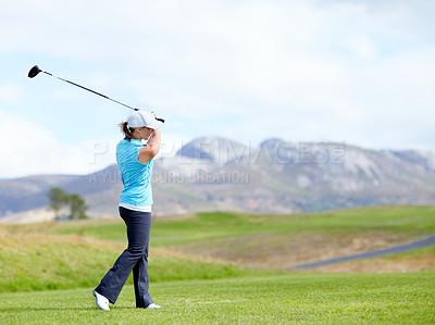 Buy stock photo A young female posed after driving the ball down the fairway
