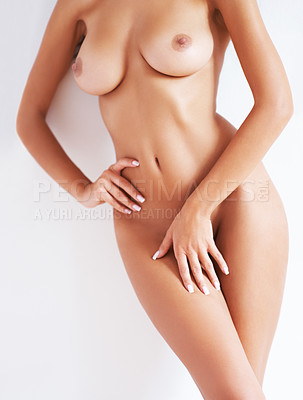Buy stock photo A cropped image of a beautiful nude woman leaning against a white wall