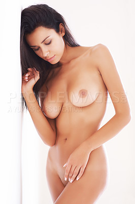 Buy stock photo A beautiful nude woman leaning against a wall with her eyes closed