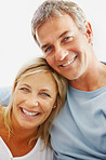 Closeup portrait of a cute mature woman smiling with a man