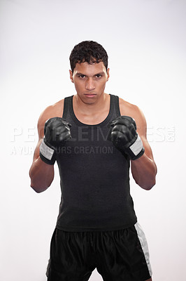 Buy stock photo Portrait of a young boxer in front of a white background