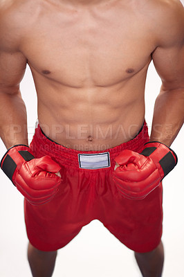 Buy stock photo Cropped image of a young boxer in front of a white background