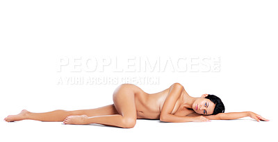Buy stock photo A portrait of a nude model lying down lengthwise on the studio floor