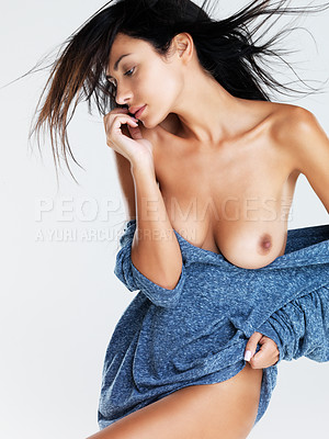 Buy stock photo A studio shot of an attractive semi-clad model wearing a blue sweater