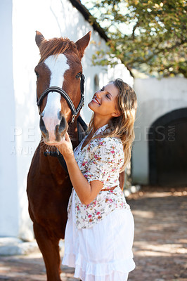 Buy stock photo An attractive woman and her horse standing outside