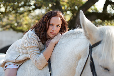 Buy stock photo Portrait of an attractive woman sitting on her horse