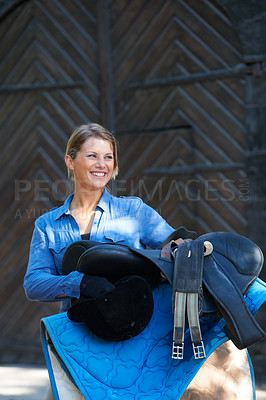 Buy stock photo An attractive woman standing outside with her equestrian gear