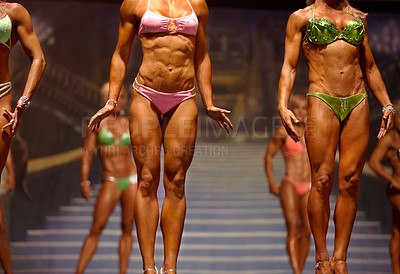 Buy stock photo Cropped view of a group of bodybuilder contestants standing in a row