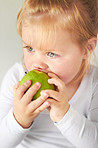 Teething on an apple