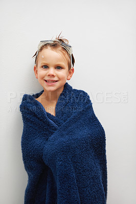Buy stock photo Portrait of a cute young boy standing in a towel after a bath