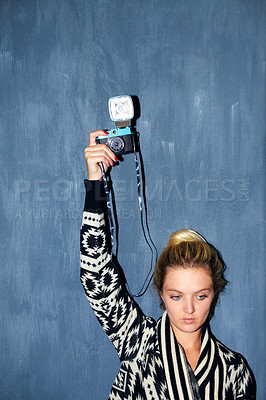 Buy stock photo Shot of an attractive hipster taking a picture with a retro camera