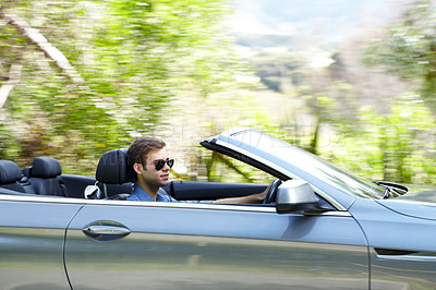 Buy stock photo A young male driving a silver convertable