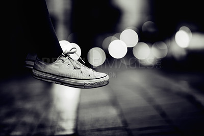 Buy stock photo Cropped image of a person wearing sneakers appearing to hover over a street