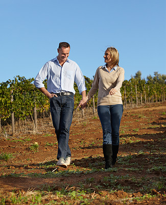 Buy stock photo A mature wine maker and his wife taking a stroll through the vineyard