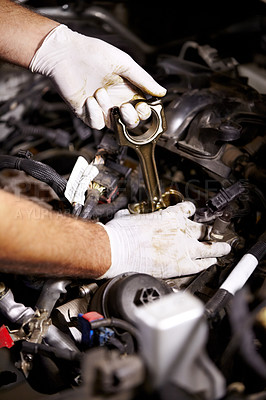 Buy stock photo Cropped image of a male mechanic's hands about to check the oil of a car