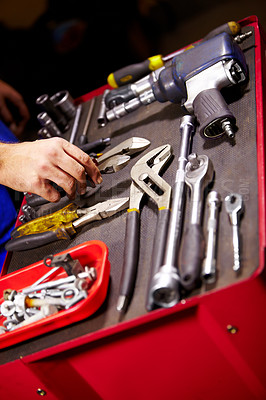 Buy stock photo Cropped image of a man's hands and a toolbox