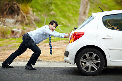 Buy stock photo Portrait of an unhappy man pushing his car