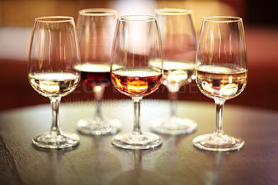 Buy stock photo Shot of five glasses of different wines on a table